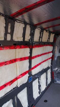 Insulating a camper van using metallic bubble wrap, fiberglass insulation, and a plastic vapor barrier.