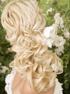 I'm in the process of growing my hair back out so I can have long, loose curls on my wedding day :)