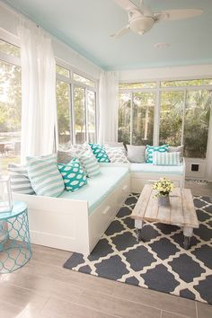 Love the blue ceiling and storage in the daybeds. I would use sofas, instead of daybeds though  i love this, really like the white curtains too, could add a floor fan, floor lanterns and a water plant feature too