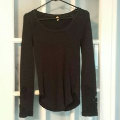 Free People Black Thermal beautiful sleeves Size large but could fit a medium.  Black thermal that has a gorgeous paisley design on the sleeves with sheer on them as well. Great piece for anytime!!!! A tad big on me. Smoke free home. Free People Tops Tees - Long Sleeve