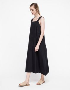 From Luisa Et La Luna, a sleeveless linen dress with clean lines and modern details. Feature a straight neckline, wide band shoulder straps, crossover back with snap button closure and a loose, relaxed fit through the body.   • Sleeveless linen dress