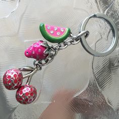 Coach key fob watermelon cherry strawberry fruit Cute key fob. Some of the enamel is wearing off. Watermelon has all gems in tack. The strawberry is missing some gems Coach Accessories Key & Card Holders