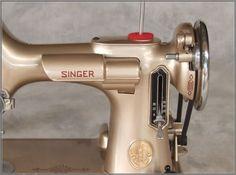"gold Singer ""221 Featherweight"" sewing machine"