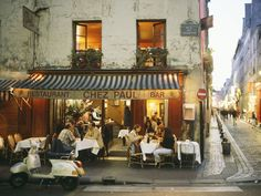 """11th arrondissement  """"The wine bar is noisy, hot, crowded, and convivial, packed with young Parisians enjoying fresh, not necessarily French food (all presented as shared small plates) and terrific wines—all at reasonable prices."""" —Ann Mah  Restaurant Info: Au Passage"""
