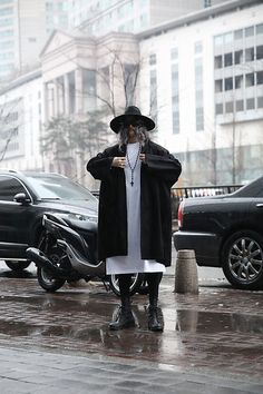 Get this look: http://lb.nu/look/8617991  More looks by INWON LEE: http://lb.nu/user/2134770-INWON-L  Items in this look:  By The R Noir Wool Felt Hat, By The R Dark Boxy Open Coat, By The R Side Slit Extra Long T Shirts   #elegant #formal #gothic #byther #black #forthepublic #justformania #embroidered #chic