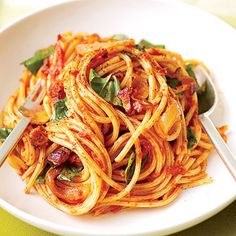 This recipe features pasta in a bacon and basil tomato sauce. Use any strands of pasta you have on your shelf--spaghetti, angel hair, or linguine. I grew up on a variant of this. It is so yummy! We used tomato soup instead of tomato sauce :) Tomato Pasta Sauce, Pasta Sauce Recipes, Italian Dishes, Italian Recipes, Italian Meals, Italian Pasta, Italian Cooking, Wrap Recipes, Dinner Recipes