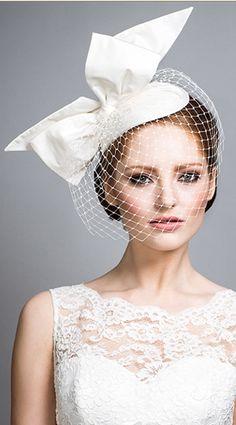 Rachel Trevor Morgan - Bridal Couture. Silk taffeta teardrop with standing bow and face veil.