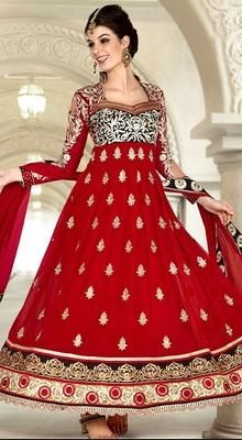 Dress up to the nines cladded in this red faux georgette long length Anarkali suit. The bodice portrays contrast thread embroidery all over in unique patterns. Kalis emphasize embroidered buttis with alternate patterns. The hemline portrays embroidered and embellished floral and Banarasi design inspired border that aggrandize the kameez. #PartywearDress