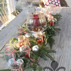Christmas centerpiece with mason jars, candles, fresh greens and mercury glass Christmas balls Holiday Centerpieces, Mason Jar Centerpieces, Rustic Centerpieces, Christmas Tablescapes, Mason Jars, Christmas Balls, Christmas Fun, Christmas Wreaths, Christmas Decorations