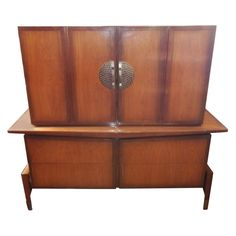 Tall Dresser by Bert England for Johnson Furniture Co.   See more antique and modern Dressers at https://www.1stdibs.com/furniture/storage-case-pieces/dressers