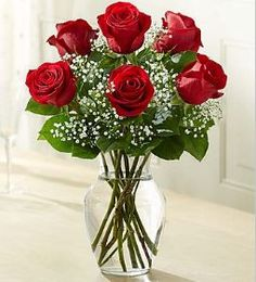 Love's Embrace™ Roses Embrace your feelings with a classic gift of red roses. Displayed elegantly in a glass vase and artistically designed, these stunning roses send a memorable message to your speci