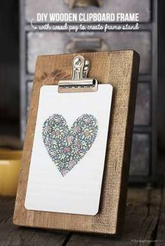 DIY Wooden Clipboard Frame to display pictures, artwork, or calendars.  A peg in the back creates a frame stand!  www.livelaughrowe.com #diy
