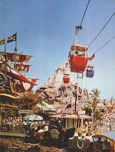 The 1965-style gondolas glide through the Matterhorn as they pass over Fantasyland's Casey Jr. Circus Train and the Pirate Ship.