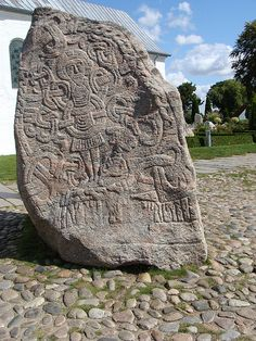 One of the two Jelling Stones, massive 10th C. runestones found at Jelling, the first capital of Denmark. The older of the two was raised by King Gorm the Old in memory of his wife Thyra. The larger of the two was raised by their son Harald Bluetooth in memory of his parents, celebrating his conquest of Denmark and Norway and his conversion of the pagan Danes to Christianity. The runic inscriptions on these stones are the most famous in Scandinavia.