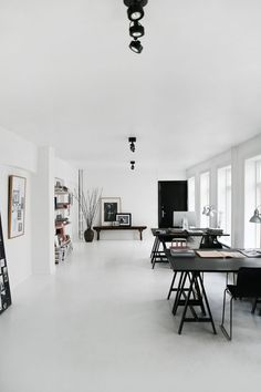 This gorgeous Scandinavian apartment is owned by a couple who are in the  business of branding various companies, something I am very familiar with.   Their beautiful home has a very consistant flow throughout that makes such  a great clean statement with all white, black and warm wood....even the  leather is in the same tones and feels just right with the rest of the  pieces. There is also a nice softness mixed with the harder lines in this  apartment. The office is also perfect with two…
