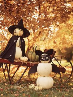 Kid-Friendly Vignette - Perfect for a children's party or as playful yard decorations, these pumpkins stack to create cheerful characters. Add masks, hats, ears, and capes for fun.