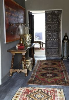 """""""A sprinkling of Turkish Kilims, French and Greek artifacts, Chinese village doors, English 18th century hand carved trunks, Spanish hand carved doors and plenty of Australian craftsmanship"""" which all combine to make a stunning global home with warmth and personality, designed by Bronnie Masefau"""
