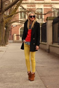 button up collared chambray shirt. mustard polka dot cropped skinny jeans. Nordic patterned red sweater. camel flat booties. black two button mid-length pea coat.