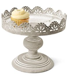 """Cold-rolled iron plus dainty scalloped punchwork equals a pretty-industrial pedestal with practical edge. The glass tray comes out for easy cleaning. (9""""W × 7½""""H; thehomeport.com)"""