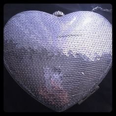 Sequenced Silver Heart Clutch! 💎💎♥️💎💎 New Silver Sequenced Heart Clutch...perfect for Prom, Wedding, Vegas, or Quince! Removable Silver long chain allows for cross body wear 48 inch long strap. Small and light. Measures 5 inches tall, 6 inches across. Heart ❤️ shaped so fits perfect as hand clutch. Fits ID, and 4x2 1/2 IPod. Meant for small items, lipstick, money, I.D. Bags Clutches & Wristlets