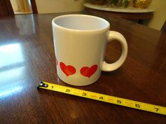 Vintage Heart Cup, West German Coffee Mug / Cup, white Cup with Red Hearts  White Cup/ Coffee Mug with red hearts all around the base Marked on bottom Waechtersbach and W-Germany Measures 4 tall and 3 at opening This cup would make a great little vintage