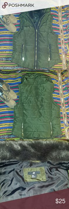 H&M OLIVE GREEN VEST with Faux Fur Collar Olive Green Vest from H&M with gold zippers,  imitation fur around collar as well as a hidden hood (shown in pic above). Shell: polyester Padding: polyester Lining: polyester Collar: imitation fur  If you have any questions do not hesitate to ask!  Feel free to make an offer! H&M Jackets & Coats Vests