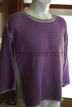 This is a crocheted summer sweater with 3/4 sleeves. It is crocheted together with a zig zag technique I usually use for joining Granny Squares.