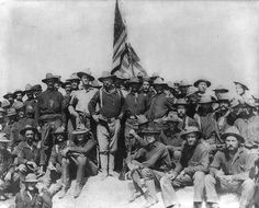 """Teddy Roosevelt and his """"Rough Riders"""" atop San Juan Hill... July 1898."""