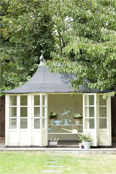 """""""House White"""" by Farrow and Ball keeps this little shed feeling light and airy."""