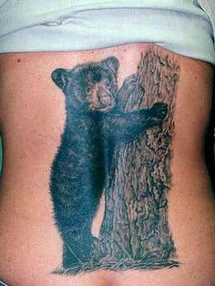 Cute Baby Bear Tattoo Design on Back....love the realistic look of this