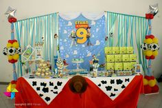 Backdrop and dessert / candy table for a Toy Story themed birthday party. Design & setup by ParteeBoo - The Party Designers