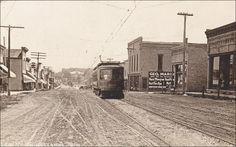 RP: Main Street (dirt) , WINNECONNE , Wisconsin , PU-1911 ; Super imposed trolly car Item# SCVIEW424476 (273208637)