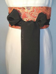 Stylish obi belt crafted from a rich Japanese brocade. Reversible so it gives you two different looks.