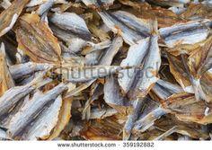 Abundance of dried salted fish at market display.