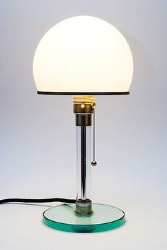 Lamp was made by a Bauhaus student and is still in production . The first commercial product of Bauhaus alumni, Wilhelm Wagenfeld — his famous opal glass lamp, conceived and still in manufacture. Design Bauhaus, Bauhaus Art, Bauhaus Style, Bauhaus Furniture, Lampe Art Deco, Design Industrial, Modernisme, Design Movements, Deco Design