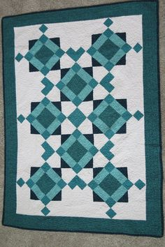 This baby quilt was inspired by the majestic state of Alaska.  Come see why in My Sister's Quilts series on the Skirt Fixation blog.