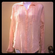Free people blouse with crinkle collar 100% cotton . A crinkle blouse with button up front . Has long sleeves . Peach color Free People Tops Button Down Shirts