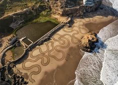 Andres Amador's Awe-Inspiring Sand Drawings Wash Away with the Tide