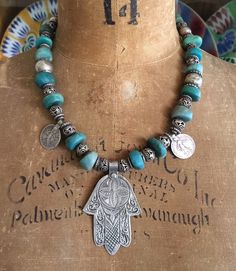images of necklaces with coral, antique Moroccan Berber silver amulets, talismans and antique trade beads for sale