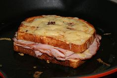 A croque-monsieur is a hot ham and cheese (typically Emmental or Gruyère) grilled sandwich.