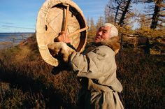 Hek, an elderly Nenets man holding his sacred drum which he made in 1946 - Yamal, W.Siberia, Russia