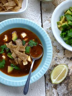 There are so many reasons to love this soup: warm and fruity pasilla chillies, charred tomatoes, avocado, fried tortilla strips, crumbled queso fresco . Fried Tortillas, Tortilla Soup, Chicken Soup, Fresco, Thai Red Curry, Tomatoes, Onion, Garlic, Avocado