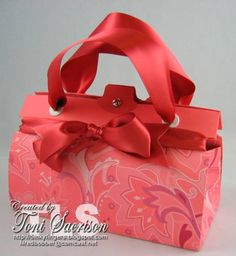 I know these purses are popping up all over the place but they really are fun and easy to make and they serve as wonderful gifts! I made this one for my pal Gretchen as a wedding shower gift. I used up a whole bunch of little scraps of designer paper and cardstock too! Bonus!  Visit my blog & play along with my Sunday Stash Challenge! http://5inkyfingers.blogspot.com  Thanks for looking!  As promised! Follow this link to the template and instructions…