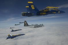 Members of the U.S. Navy Flight Demonstration Squadron, the Blue Angels, refuel in flight with the help of Marine Aerial Refueler Transport Squadron 252 (VMGR-252) stationed in Cherry Point, N.C., on their return flight from an air show at the National Cherry Festival in Traverse City, Mich. Military Jets, Military Weapons, Military Aircraft, Us Navy Blue Angels, Uss Theodore Roosevelt, Angel Flight, Old Planes, Aircraft Pictures, Air Show