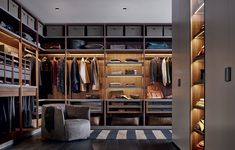 Senzafine walk-in closet in walnut c. melamine with lateral side frame.