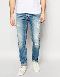 Imagen 1 de Vaqueros de corte tapered con acabado muy desgastado y lavado vintage claro Flint de Pepe Jeans