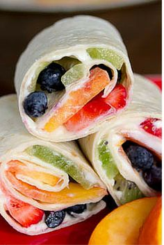 """Use fresh summer berries, peaches, and kiwi to make Dessert Pizza Pinwheels! Spread a tortilla with a cream cheese """"sauce"""" to create healthy fruit roll-ups. Roll Ups Recipes, Wrap Recipes, Fruit Recipes, Dessert Recipes, Cooking Recipes, Juicer Recipes, Strawberry Recipes, Salad Recipes, Yummy Appetizers"""