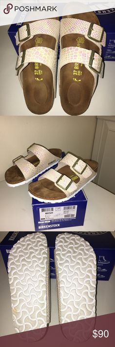 Beautiful Birkenstock sandals almost brand new Shiny Snake Cream Birkenstock sandals in its box, wore just one time for less than 3 hours. The material is nice iridescent, the pictures really don't do justice to its beauty. Narrow fit Birkenstock Shoes Sandals