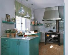 Blue Kitchen Cabinets!!!  Also LOVE  the Hearthstone Stove!!!