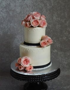 Sweetheart roses and pearls - White almond cake with raspberry cream filling iced in vanilla buttercream with black fondant ribbon and fondant pearl border. Round Wedding Cakes, Creative Wedding Cakes, Wedding Cake Photos, Creative Cakes, Cake Wedding, Wedding Cookies, Buttercream Designs, Buttercream Flowers, Vanilla Buttercream